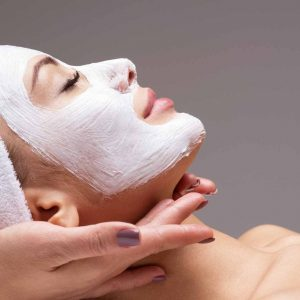 spa-massage-for-woman-with-facial-mask-on-face-JYQT67W.jpg